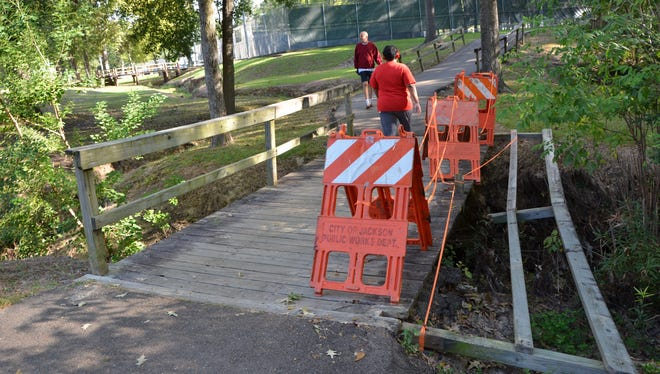 A railing on a bridge in Parham Bridges park in north Jackson has been down for two weeks according to the City of Jackson.