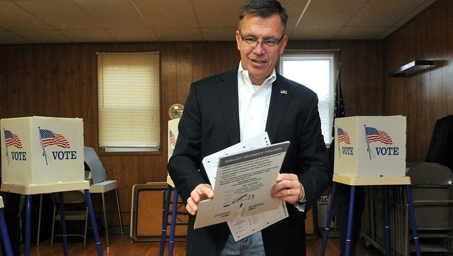 Bobby Schilling, Republican candidate for Congress, casts his ballot on election day at a polling place in Cleveland, Ill. Schilling is running to retake Illinois' 17th congressional seat from incumbent U.S. Rep. Cheri Bustos.