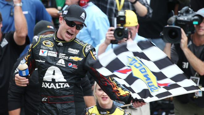 Jeff Gordon on July 27, 2014, celebrates his fifth Brickyard 400 win at the Indianapolis Motor Speedway.
