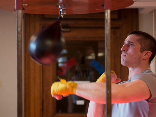Evansville firefighter Adam Brock works out on a speed bag during a Hoses team practice at the Guns and Hoses Gym in Old Vanderburgh County Courthouse on Friday, March 30, 2018. The Guns and Hoses event pits law enforcement officers against firefighters in night of charity boxing matches on April 7.