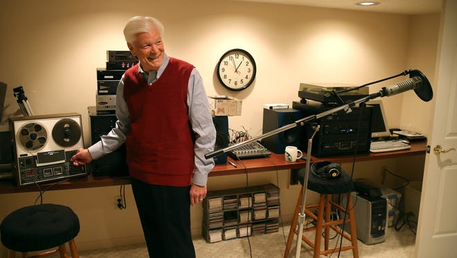 Alhart has a small sound studio in his basement with a variety of technologies going back to reel-to-reel format, the machine he's pointing at in this picture.