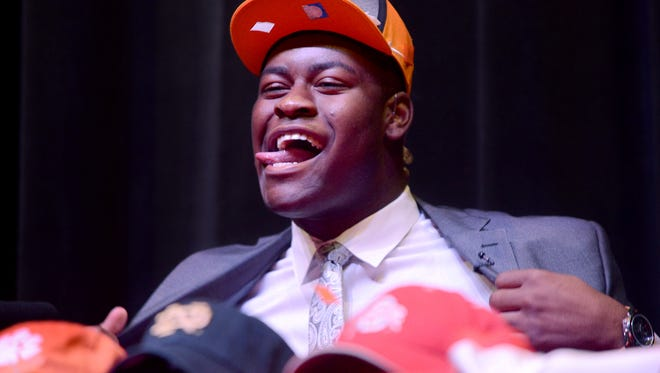 University School of Jackson senior lineman Trey Smith reacts after choosing The University of Tennessee as his commitment choice, Tuesday afternoon.