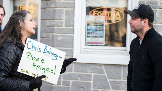 Patricia Steely, who organized a protest demanding Chris Behney issue an apology, speaks to Behney, founder of Just Wing It, speaks to a group of 15 people protested outside of Just Wing It in Annville on Sunday, Feb. 5, 2016 demanding Behney issue an apology after using a racial slur against a Lebanon Valley College student on Sunday, Jan. 22, 2016.