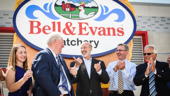 Gov. Tom Wolf gives a thumbs up to Scott Sechler Sr., chairman and president Sechler Family Foods, Inc. after he cut the ribbon on Thursday, June 22, 2017 to open a new $40 million organic chicken hatchery in Fredericksburg, PA, the first of its kind in the United States, according to Bell & Evans.