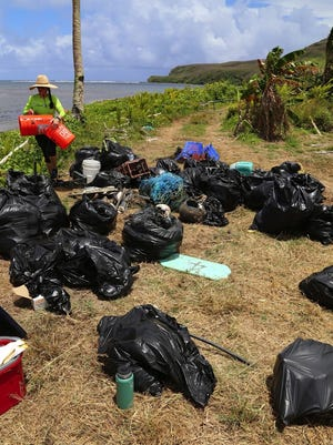 In this June 2016 file photo, debris collected by Guam Nature Alliance R2R Pago Adventurers  sits near the shore at Pago Bay after the group worked to clean the shoreline to protect the oceans. Most of the trash on the shoreline on this section of Pago Bay comes from the open ocean drifting to Guam on the ocean currents. The participants collected, sorted and categorized the marine debris, including the micro-plastics, which are mistaken for food and eaten by many marine animals.