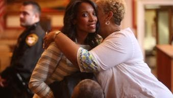 Judge Tracie Hunter gets a hug as she enters court on Wednesday.