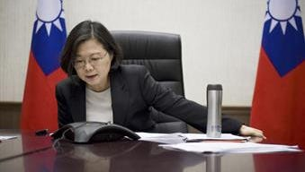In this Friday, Dec. 2, 2016, file photo, released by Taiwan Presidential Office, Taiwan's President Tsai Ing-wen speaks with U.S. President-elect Donald Trump through a speaker phone in Taipei, Taiwan. China on Wednesday accused Taiwanese President Tsai Ing-wen of seeking to use a planned transit stop in the U.S. to score diplomatic points, amid Chinese rancor over an unprecedented phone call between Tsai and U.S. President-elect Donald Trump