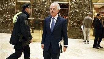 Sen. Bob Corker, R-Tenn., walks to talk with reporters in the lobby of Trump Tower after a meeting with President-elect Donald Trump Nov. 29 in New York.