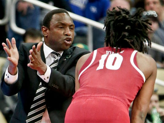 Alabama head coach Avery Johnson, left, gives instruction to Herbert Jones (10) as they play against Villanova during the first half of a second-round game in the NCAA men's college basketball tournament, Saturday, March 17, 2018, in Pittsburgh. (AP Photo/Keith Srakocic)