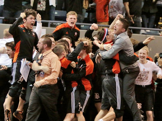 Brighton coaches and wrestlers celebrate after winning