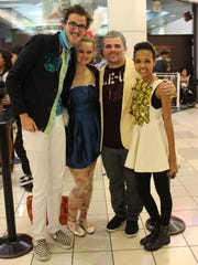 Ethan Zimmerman, is shown at a film premiere in Guam in a 2013 file photo. From left, Zimmerman, Rosie Zimmerman, De'Andrew Brown (dressed as Hunger Games Capitol citizens) and Angelica Rohr (dressed as Effie Trinket).