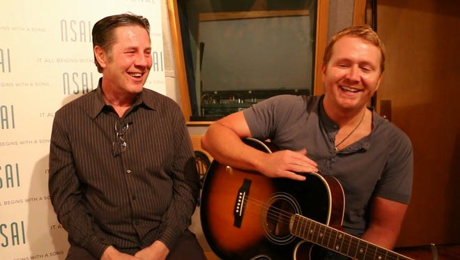 "Shane McAnally, right, laughs with Bart Herbison, left, as he recalls writing ""Merry Go 'Round."""