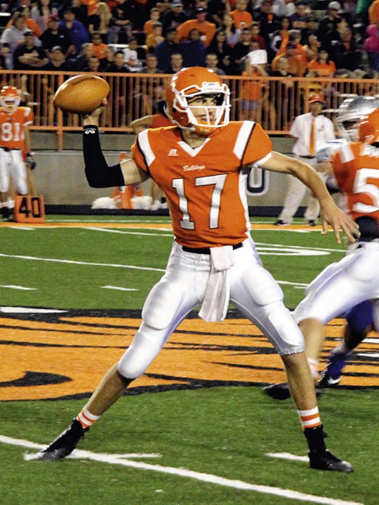 Matt Hollinshead — Current-Argus Artesia quarterback Justin Houghtaling throws the ball in the second quarter against Carlsbad Friday, Sept. 26, 2014. Houghtaling will be back for his senior year.