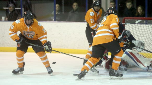 John Myers of White Plains tries to backhand a shot