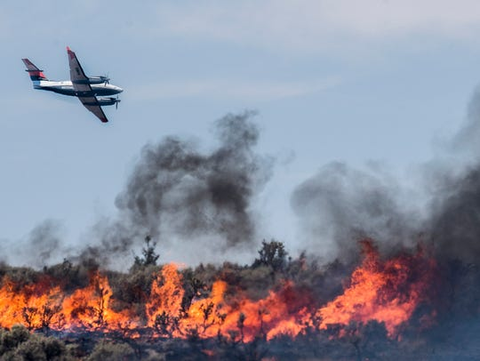 Aircraft survey the flames at the Black Mountain Fire