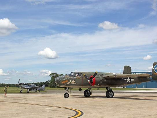 A B-25 Mitchell bomber and a P=51 Mustang land at Millville
