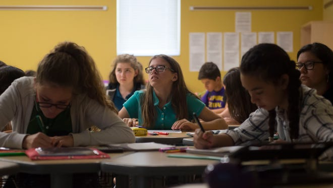 Freshman student Samantha Callanan, 14, listens to instructor Jessica Shovan during her honors Algebra II class in October at Fort Pierce Central High School in Fort Pierce. Lawmakers in 2016 blurred school-district boundaries by allowing parents to enroll children in any public school beginning this year, so long as space is available.