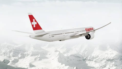 An imagine showing an image of a Boeing 777-300ER in the colors of Swiss International Air Lines.