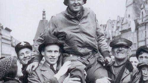 Matt Konop carried by the townspeople of Domazlice, Czechoslovakia, in 1945.