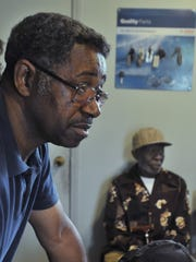 In this May 30, 2014, file photo, Freddie Porterfield, left, talks about problems getting treatment for his uncle, Willie McCall, a Korean War veteran.