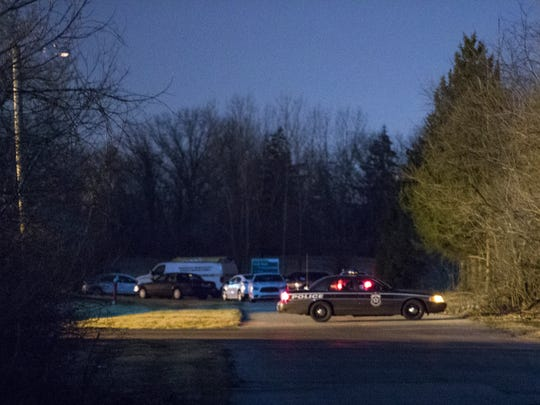 IMPD vehicles and a crime lab van were in the 6400 block of Olivia Lane where human remains were found Monday night.