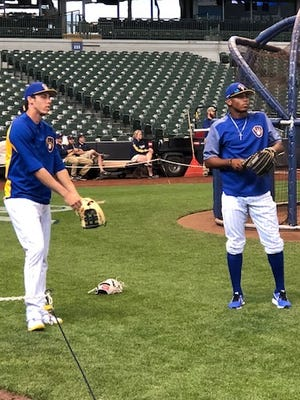 Brewers second-round pick Joe Gray (right) works out with Christian Yelich.