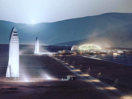 Artist rendering of SpaceX spaceships at a settlement