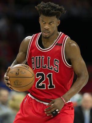 Chicago Bulls forward Jimmy Butler dribbles against the Philadelphia 76ers during the second quarter at Wells Fargo Center.
