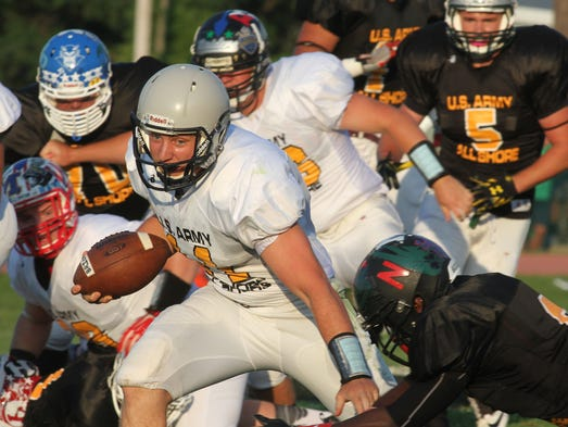 Quarterback Tom Kelly of Lacey and the Ocean squad runs for yardage against Monmouth during the U.S. Army All-Shore Gridiron Classic at Brick. Thursday July 17, 2014, Brick, NJ. Photo by Robert Ward