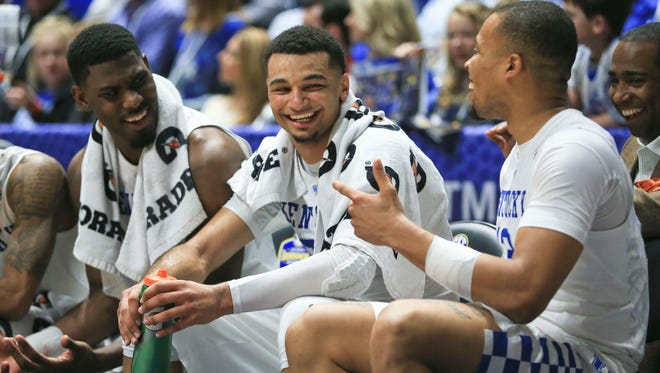 Kentucky's Alex Poythress, Jamal Murray and Isaiah Briscoe relaxed toward the waning moments of the Wildcats' 85-59 win over Alabama Friday.