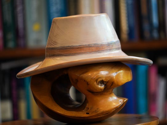 Dr. Neil Kaye brought this wooden hat with him to the
