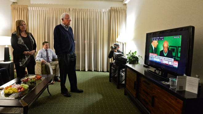 Bernie Sanders watches caucus results Monday night in Des Moines.