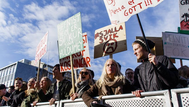 People gather during a protest in front of the Icelandic Parliament in Reykjavic on Apr. 4 calling for the resignation of Prime Minister Sigmundur David Gunnlaugson, who is implicated in a leak about secret offshore companies.