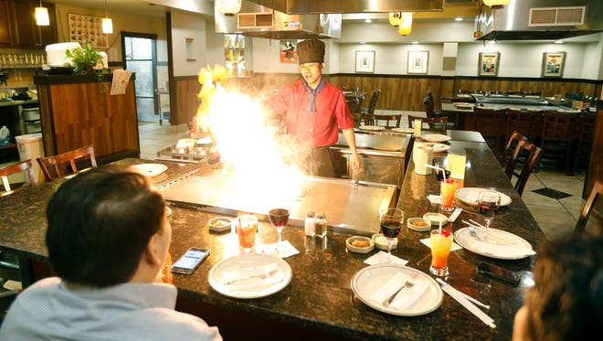 Chef Cin Khan gets the hibachi grill started for a meal at Ichiban. Hibachi is the show aspect of Japanese cooking,