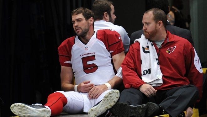 Drew Stanton of the Arizona Cardinals gets carted off of the field after getting injured on a sack against the St. Louis Rams on Thursday, Dec. 11, 2014.