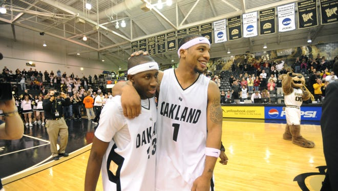 Johnathon Jones and Derick Nelson embrace after a 2010 game during their senior seasons at Oakland University. Jones, from Okemos, and Nelson, from Everett, were critical pieces in building Oakland's program.