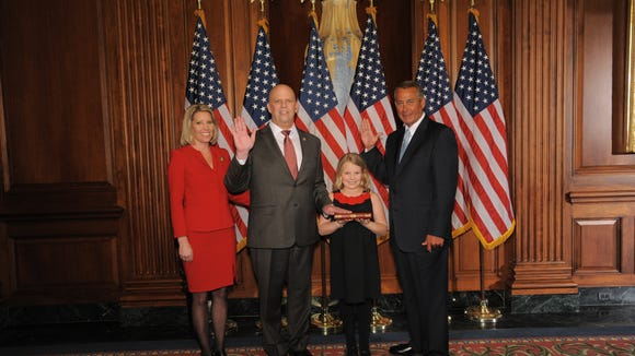U.S. Rep. Scott DesJarlais (second from left) poses with his family and Speaker John Boehner moments after DesJarlais helped an effort to unseat the speaker.