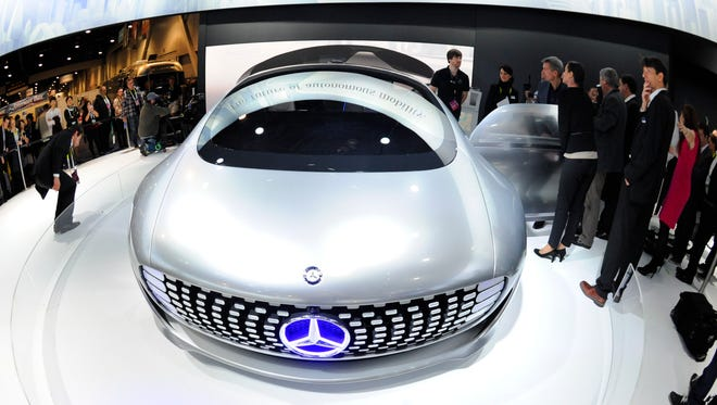 People inspect the Mercedes-Benz F015 Luxury in Motion vehicle on Jan. 6.
