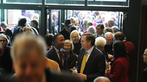 Guests arrive at the Ryman Auditorium for a prayer