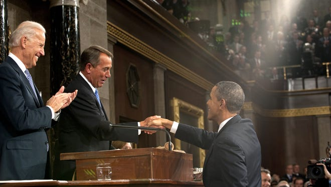 President Barack Obama shakes hands with House Speaker John Boehner as Vice President Joe Biden watches before Obama delivers his State of the Union address on Capitol Hill in Washington, Tuesday, Jan. 24, 2012.