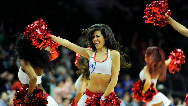 A Philadelphia 76ers cheerleader performs during an NBA basketball game against the Detroit Pistons on Wednesday, Jan. 28, 2015,