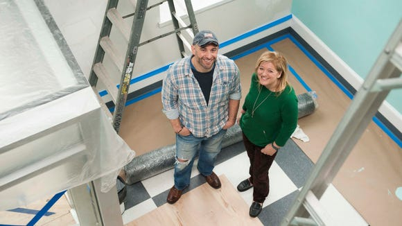 Portrait of the Medford Pop Shop co-owners Connie Correia and Bill Fisher, January 18, 2015 in Medford.