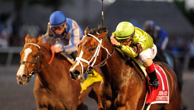 Constitution (rail) held off Lea to win the Grade I Donn Handicap at Gulfstream Park.