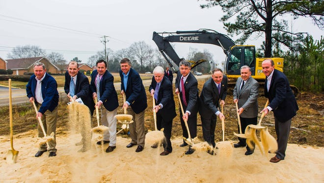 Officials break ground at the construction site of Highway 471 in Brandon.
