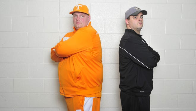 Tennessee fan Stephen Crutchfield and Vanderbilt fan Chad Caldwell pose for pictures in La Vergne, Tenn. March 7, 2015.