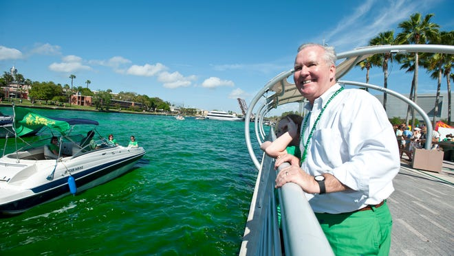 Tampa mayor Bob Buckhorn watches as the Hillsborough River is dyed green for St. Patrick's Day. Buckhorn started the tradition in Tampa four years ago.