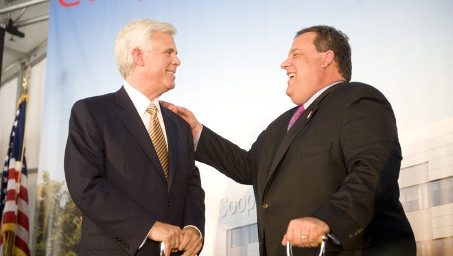Influential Democrat George Norcross,  chairman of the board of Cooper University Hospital, and Gov. Chris Christie chat following a groundbreaking event for the Cooper Cancer Institute in 2012. Cooper University Hospital will receive $40 million from the Economic Development Authority, mostly for returning 353 employees that it previously moved to the suburbs.