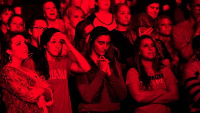 Belmont University students Sira Faris, Sara Whittemore, Lindsay Maxoutopoulis and Emily Howe watch the last few second of the Belmont game as they lost to University of Virginia 67-79 on Belmont University campus in the Curb Event Center in Nashville, Tenn. March 20, 2015.