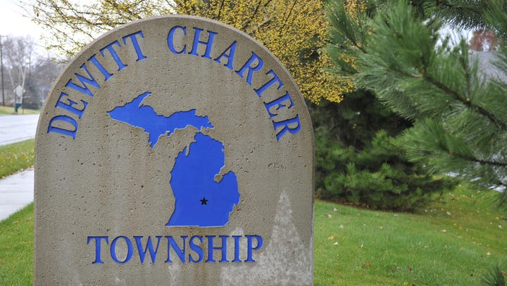 DeWitt Twp. sign at township offices  police vehicle