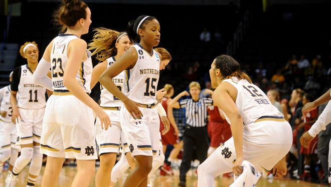 Mar 27, 2015; Oklahoma City, OK, USA; The Notre Dame Fighting Irish celebrate after a play against the Stanford Cardinal during the first half in the semifinals of the Oklahoma City regional of the women's 2015 NCAA Tournament at Chesapeake Energy Arena. Mandatory Credit: Mark D. Smith-USA TODAY Sports